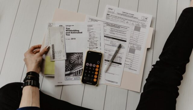 Tax forms along with a calculator.